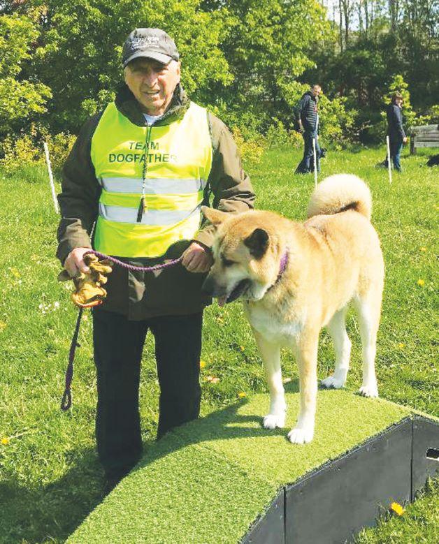 Vic Barlow training a dog.