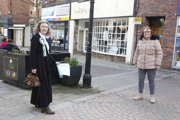 Left, Heather Watson dressed as a suffragist to mark the spot where the life size statue of Elizabeth Wolstenholme Elmy will be unveiled in Congleton town centre next year with Susan Munroe, chair of Elizabeth's Group.