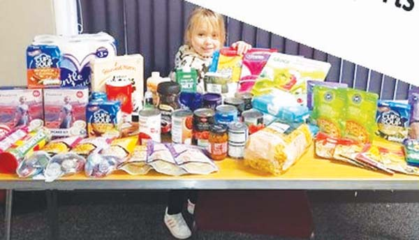 Layney - instead of doing Christmas cards at school she bought food for the foodbank.