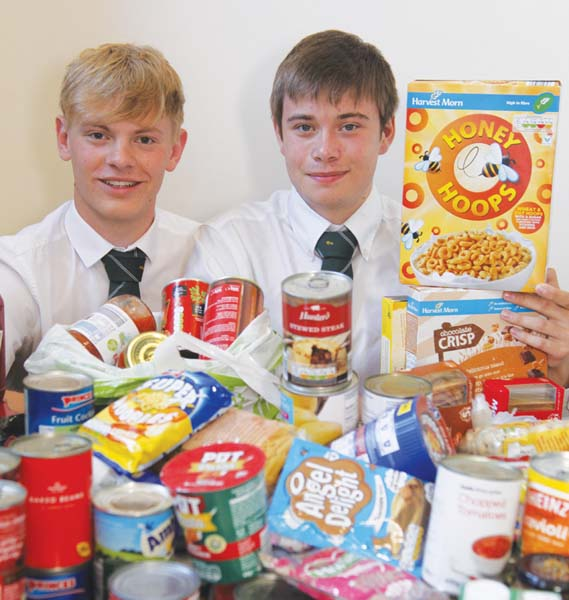 Back in 2018, head boy at Sandbach School George Higginson and deputy head boy Kobi Walter, both then aged 17, with some of the food collected by the school for the Trussell Trust.