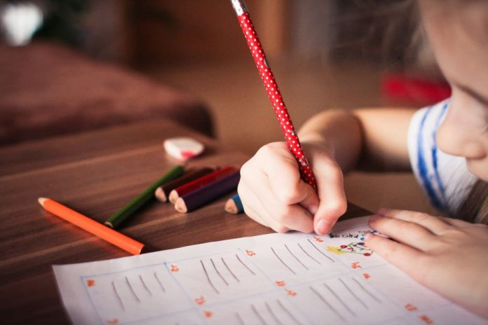 A primary school pupil working.