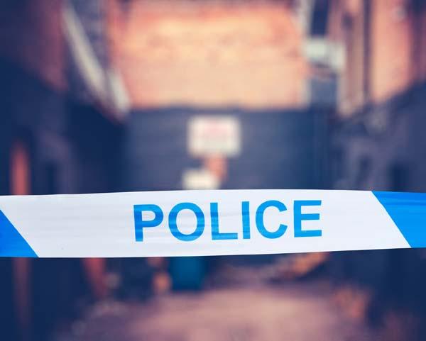 Police Tape In Urban Alley