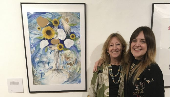 Miss Hatton, right, and mum Jacqueline with an artist's painting of her experiences.