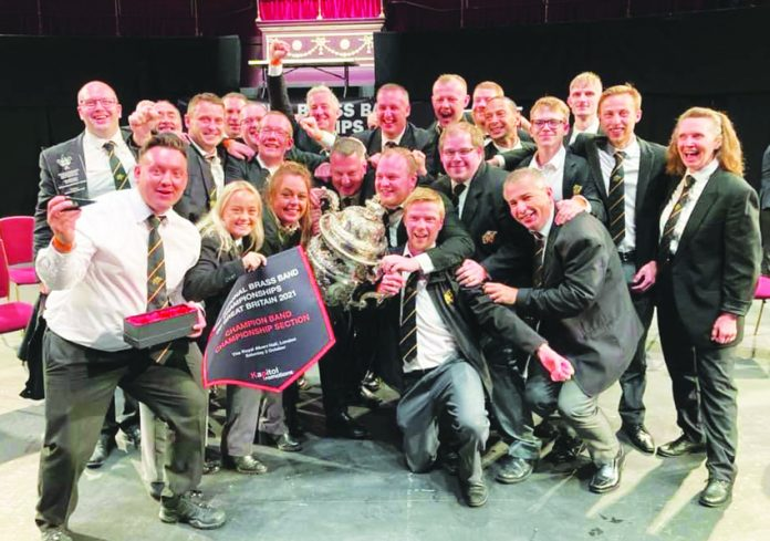Foden's Brass Band with the trophy